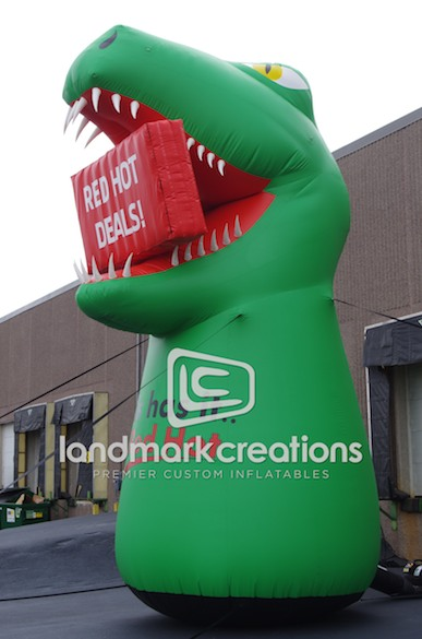 Photo: Promote special offers with message areas added to a custom inflatable. Hall's Homes added a giant billboard space in the jaws of their inflatable dinosaur mascot to change messages (e.g. Red Hot Deals!) as needed.