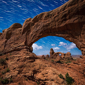 Arches at night by Jeff Fahrenbruch - Landscapes Mountains & Hills ( national park, arches national park, utah, night, star trail, arches np north window arch, arches np turret arch )