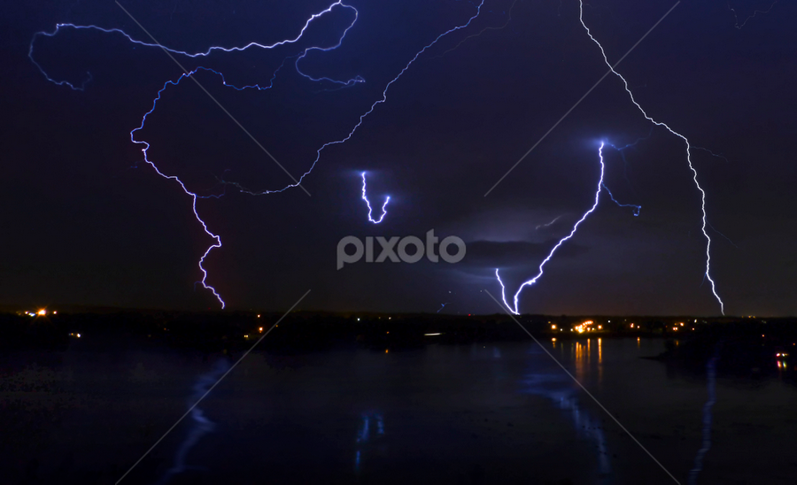 sizzling storm! by Marianna Armata - Landscapes Weather ( thunder, water, reflection, pwcstorm, sizzling, landscape, storm, marianna armata, strike, lightning, night, light, river )