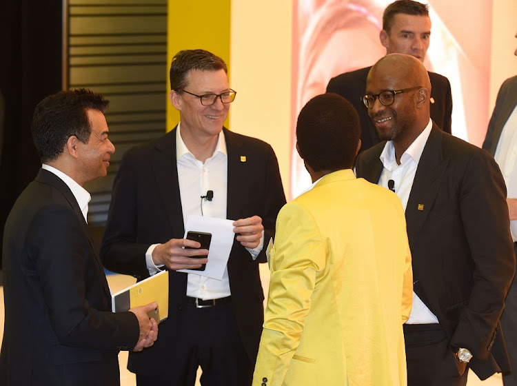 New focus: MTN Group CEO Rob Shuter, centre, and chief financial officer Ralph Mupita, right, at the company's interim financial results presentation in Fairland, Randburg, on Thursday. FREDDY MAVUNDA
