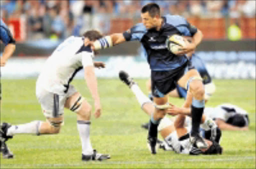 CAN'T TOUCH: Pierre Spies leaves Josh Blackie helpless during the Super 14 match between the Bulls and Auckland Blues at Loftus Stadium in Pretoria. 21/02/09. Pic. Lee Warren. © Gallo Images.