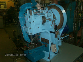 Photo: Grommet machine automatic spur and washer