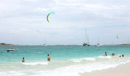 Parasailing, jetskiing and other water sports vie for attention at Orient Bay in St. Maarten.