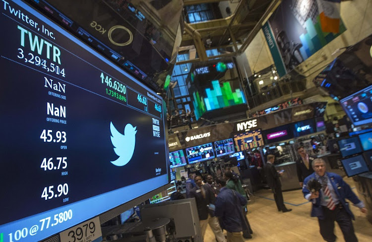 The Twitter logo is displayed on the floor of the New York Stock Exchange. Picture: REUTERS