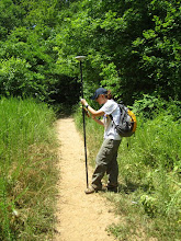 Photo: Colleague, Erin Dempsey of Midwest Regional Archaeology Center, working with a Trimble GPS during a Pedestrian Survey of Horse Trails.  Summer 2010 Cultural Resources Diversity Internship at Ozark National Scenic Riverways in Missouri.