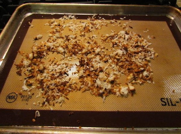 Set your oven to broil, place your 1/2 cup coconut evenly all over a...