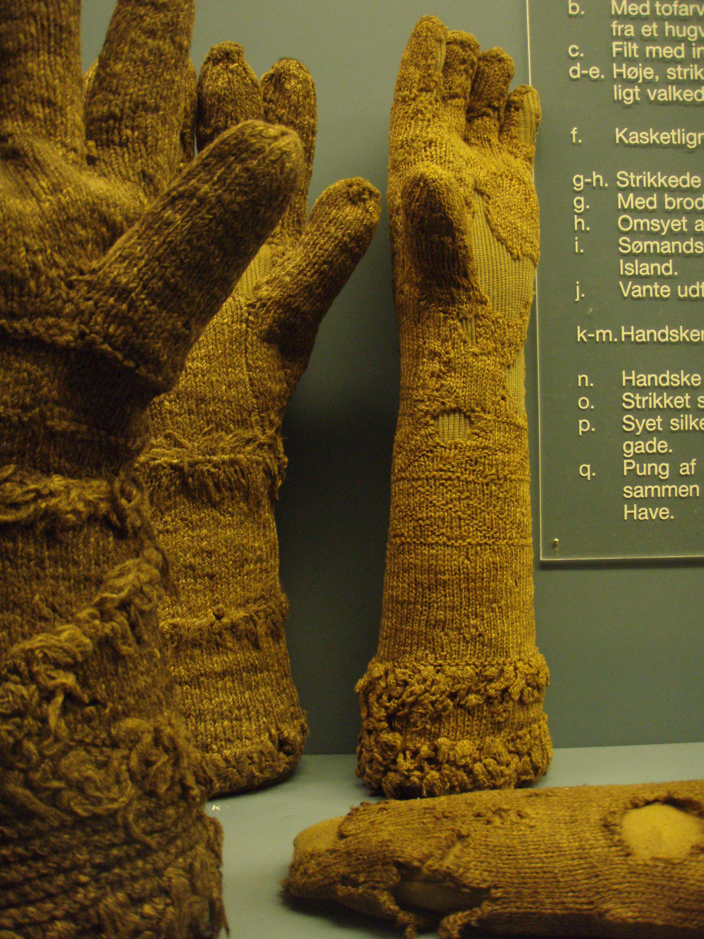 "Photo: Gloves (k,l,m): ""cuffs have stripes of imitation fur."" Toe of stocking (o)."