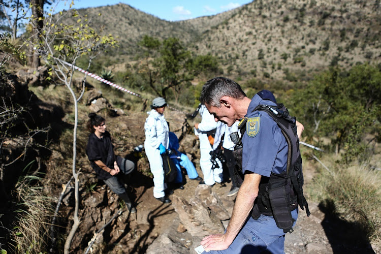 Police investigate the gruesome discovery of two badly decomposed bodies in a cave at a smallholding in Hennops River Valley on May 22 2018.