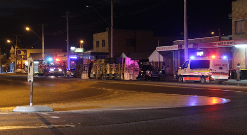 Emergency services attend to an overturned water truck on Tibbereena Street on Tuesday evening.