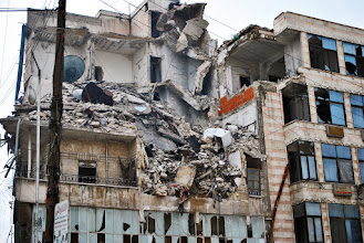 Photo: A building badly damaged by government shelling in the neighbourhood of Jabal Badro in Aleppo, Syria. 11/4/ 2013. Credit: Ali Mustafa/SIPA Press