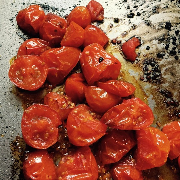 Place  tomatoes chopped in half on sheet pan.  Toss in a tablespoon...