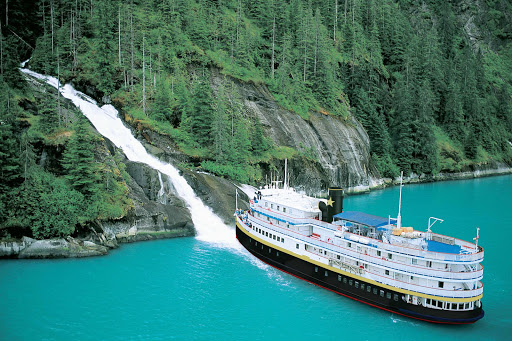 SS_Legacy_in_SE_Alaska_waterfall.jpg - The 88-passenger S.S. Legacy stops by a waterfall in southeastern Alaska.