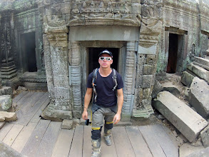 "Photo: As the temples of Angkor cover a huge area, I took my motorbike to go to the different sights – in contrast to the information I got from my guest house, it is allowed to do so. That's why I explored the temples wearing all my motorbike gear. FAQ: ""Isn't it very hot?"", A: ""Yes, it is."""
