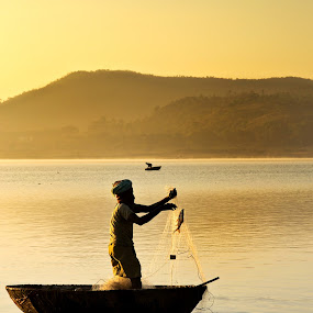 Golden hour fishing by Sudarshan Hp - Landscapes Waterscapes
