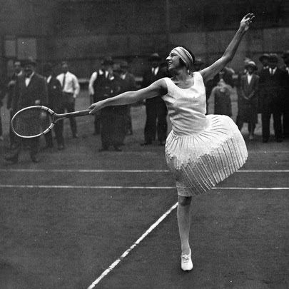 French tennis player, Suzanne Lenglen, the ballerina of tennis, returns a hit during a match in the 1920s