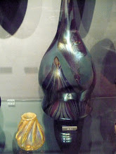 Photo: Tiffany Vases. Favrile glass.  Blue (1893–94): http://www.metmuseum.org/Collections/search-the-collections/10009708  Yellow (1893): http://www.metmuseum.org/Collections/search-the-collections/10009727