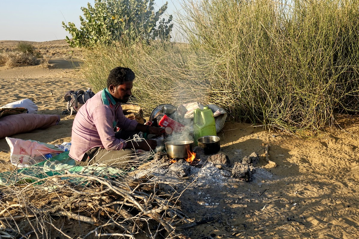 India. Rajasthan Thar Desert Camel Trek. Punja preparing our evening chai