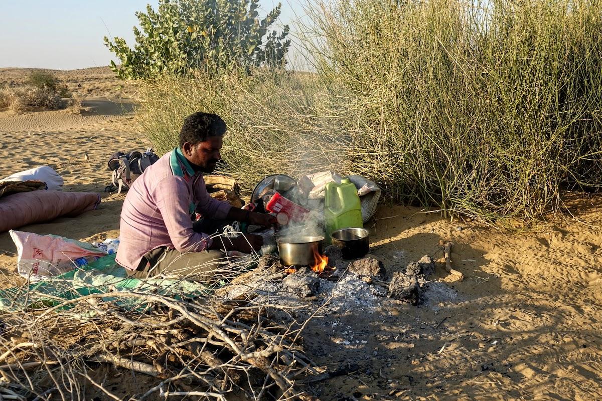 India. Rajasthan Thar Desert Camel Trek. Punja preparing our evening chai