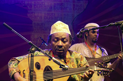 Mohamed Issa Haji performs with Swahili Encounters, a project in which Zanzibari musicians collaborate with musicians from other countries at the Sauti za Busara festival