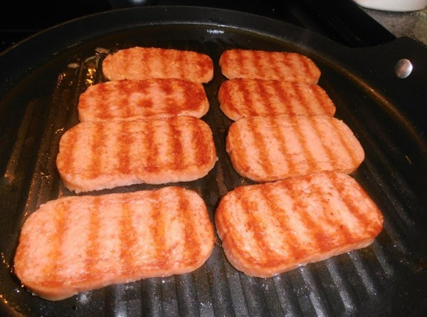 In large frying pan or on griddle, heat 1 tablespoon oil. Add onion; fry...
