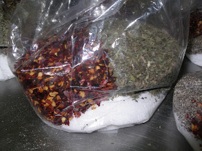 """Photo: My own private and undisclosed portions of  Oregano, Basil, Parsley, crushed red hot peppers,  garlic powder, sugar, salt, and pepper.  I boil these 8 items as a """"loose-tea"""" in boiling water to melt  down the Sugar, salt, and garlic to a liquid form, as well as extract  maximal flavors from the herbs.  I add the entire brew with loose herbs into my cold crushed plum tomatoes.  No cooking of tomatoes necessary!  Taste most fresh and flavorful this way.  Don`t tell anyone."""