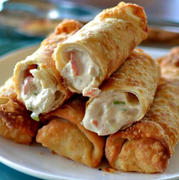 Crab Rangoon Egg Rolls Are Filled With Fresh Crab Meat, Cream Cheese And A Perfect Blend Of Spices.  They Are Fried To Golden Perfection And Are The Ultimate Party Appetizer.