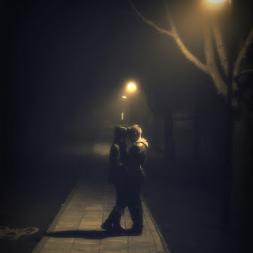 Hold Me Closer Than That by Dhruva Chandramouli - People Couples ( fog, couple, streetlights )
