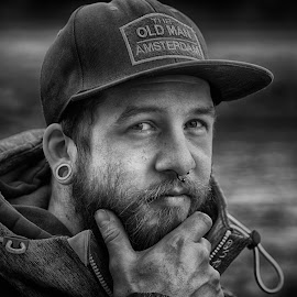 The Old Man From Amsterdam by Marco Bertamé - Black & White Portraits & People ( cap, beard, young, headshot, bearded, looking, man, portrait, hand )