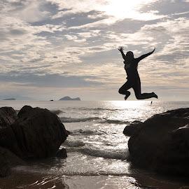 Jump High by Etty Selamat - Uncategorized All Uncategorized ( sunset, beach, people, rocks, jump,  )