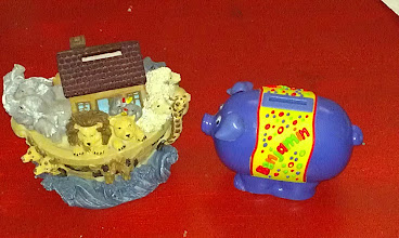 Photo: These are the two banks that The Boy uses to save all of his coins. The piggy he got from his Uncle Brad when he was born and Noah's Ark he got for his 3rd birthday from Granny!!