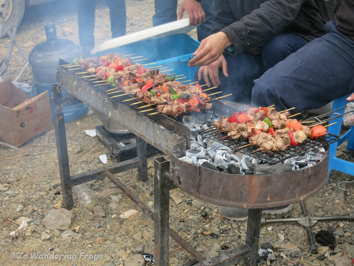 Mongolia. Golden Eagle Festival Olgii. Freshly-barbecued skewers