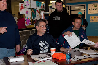 Photo: Sue, Mike, Kevin and Craig signing up runners...