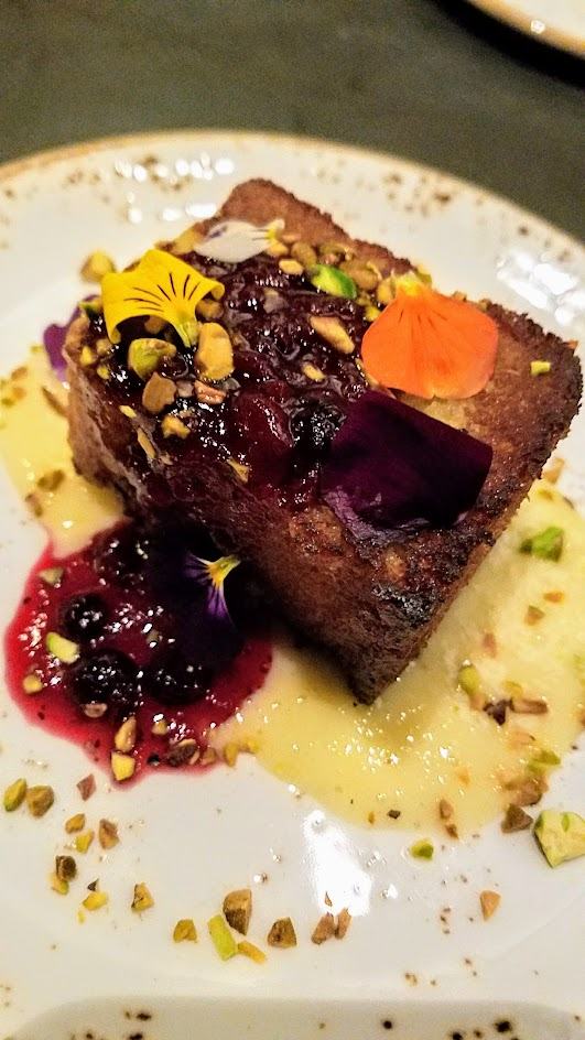 Quaintrelle, Pacific Northwest cuisine focused Portland restaurant that emphasizes 80-85% local ingredients. Dessert of olive oil cake with lemon curd, huckleberry, pistachios