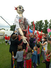 Photo: One of four giant puppets on Parkers Piece, Cambridge for Olympic welcome