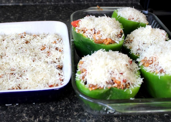 Carefully fill peppers. Place remaining extra filling in 1 1/2 quart dish. Top both...