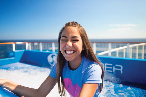 Harmony-of-the-Seas-flowrider-girl.jpg - Have fun and cool off by tackling FlowRider on Harmony of the Seas.