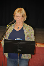 """Photo: Carol McCarthy, widow of the late Jack McCarthy, reads Jack's contribution to the book, """"I Didn't Miss the Robins."""""""