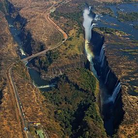 Victoria falls by Blaz Crepinsek - Landscapes Waterscapes ( livingstone, zambezi river, zambia, , bridge )