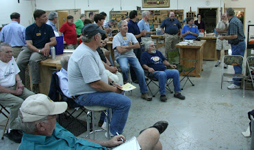 Photo: Members listen to announcements from MCW President Bert Bleckwenn