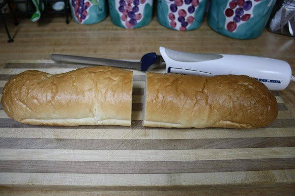 Using an electric knife, slice the bread in half.  (Find a french loaf...