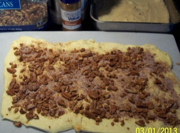 Combine the pecans, white sugar and cinnamon,  sprinkle evenly over the dough that is...