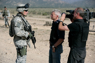 Photo:  Paktika Province, FOB Bermel, Afghanistan: CNN Anchor Anderson Cooper and Field producer Charlie Moore and Photojournalist Phillip Littleton at US foward operating base Bermel in the Paktika Province in Afghanistan. The CNN crews shot the 9/11 anniversary at the base and went on patrol with both US and Afghan Army soldiers. While at the base the crew experienced a rocket attack from insurgents which forced the initial 9/11 comemoration to be halted while the soldiers sought shelter underground in bunkers.  Photo by Brent Stirton/Getty Images