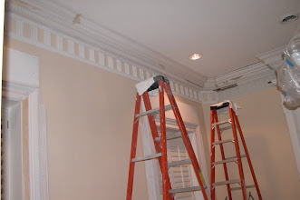 Photo: December 2006 - Month 40: Installation of the new living room crown molding. The entire front wall has new medallions molded by Raymond