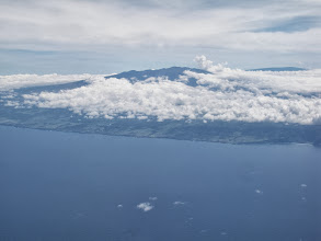 Photo: At almost 14,000 feet the twin peaks of Mauna Loa and Mauna Kea stick up above the clouds. They are the tallest mountains in the world when measured from the ocean floor.