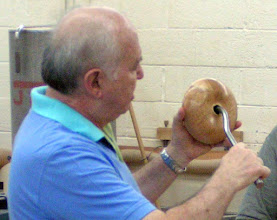 Photo: Eliot Feldman shows how he uses this swan-neck tool to hollow a form.