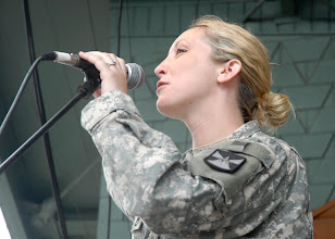 "Photo: Staff Sgt. Jennifer McDonald sang ""Back in the USA"" during the 34th Red Bull Infantry Division Band's performance at the Minnesota State Fair's Military Appreciation Day Aug. 30, 2011 in St. Paul, Minn."