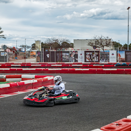Karting racer in action by Roberto Sorin - Sports & Fitness Motorsports ( car, position, person, wheel, indoor, sports, go-kart, helmet, race, championship, spain, karting, competing, adventure, kart, nature, racing, motor, drive, action, lap, driver, gokart, adrenalin, motion, man, editorial, speed, track, sport, cart, leisure, karts, fun, young, gocart, malaga, background, circuit, racer, carting, fast, competition, go,  )