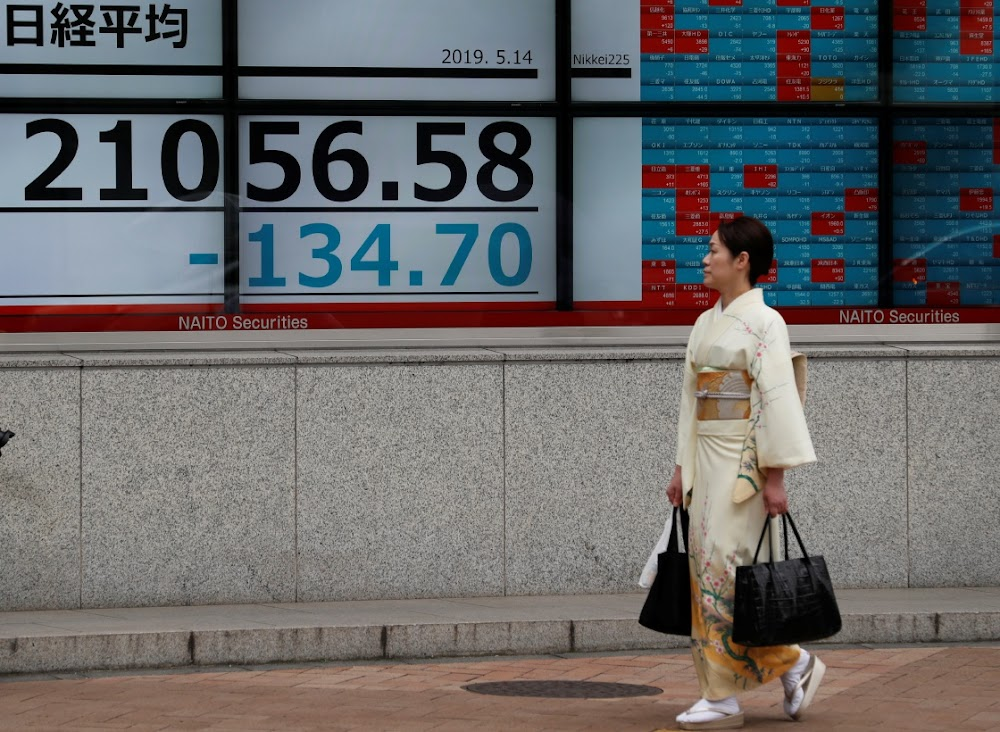 Asian stocks crimped by delay in US-China talks