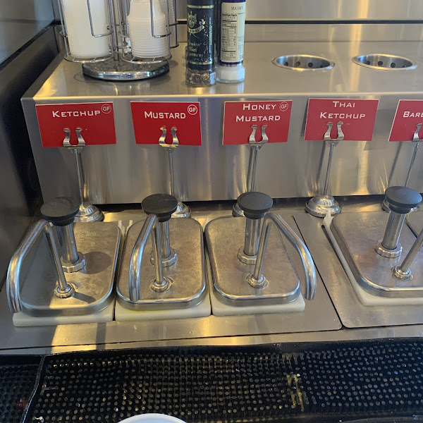 Clearly labelled self serve condiments - many GF