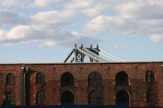 Photo: An old, rundown warehouse on Water Street with the Manhattan Bridge soaring up behind it.